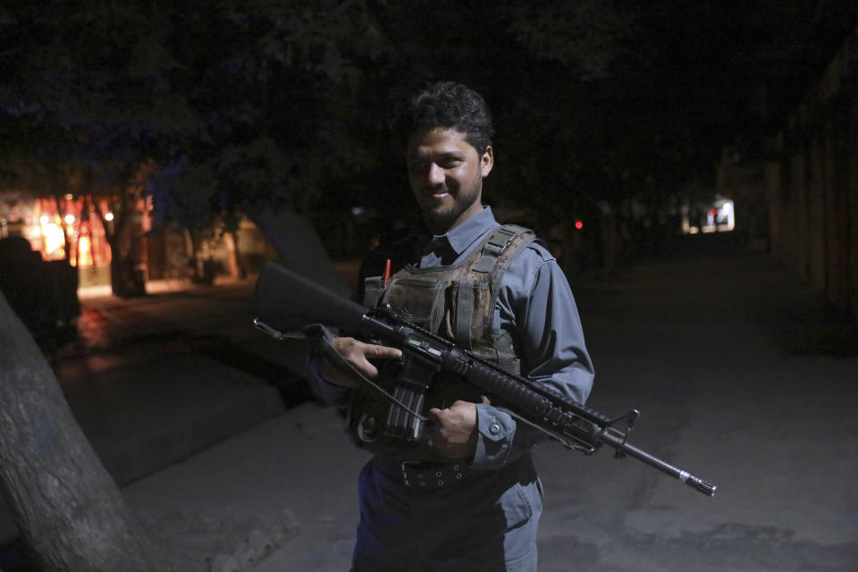 An Afghan security personnel arrives at the site of a bomb explosion in Kabul, Afghanistan, Tuesday, June 1, 2021. An Afghan government spokesman says two bombs exploded in quick succession in separate locations of a neighborhood in west Kabul, leaving multiple people dead and wounded. (AP Photo/Rahmat Gul)