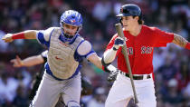 Toronto Blue Jays catcher Reese McGuire, left, tags out Boston Red Sox pinch-hitter Jarren Duran, right, on a strikeout during the seventh inning of a baseball game at Fenway Park, Wednesday, July 28, 2021, in Boston. (AP Photo/Charles Krupa)