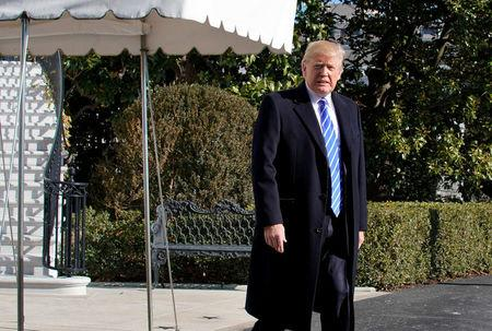 President Donald Trump walks out from the White House in Washington