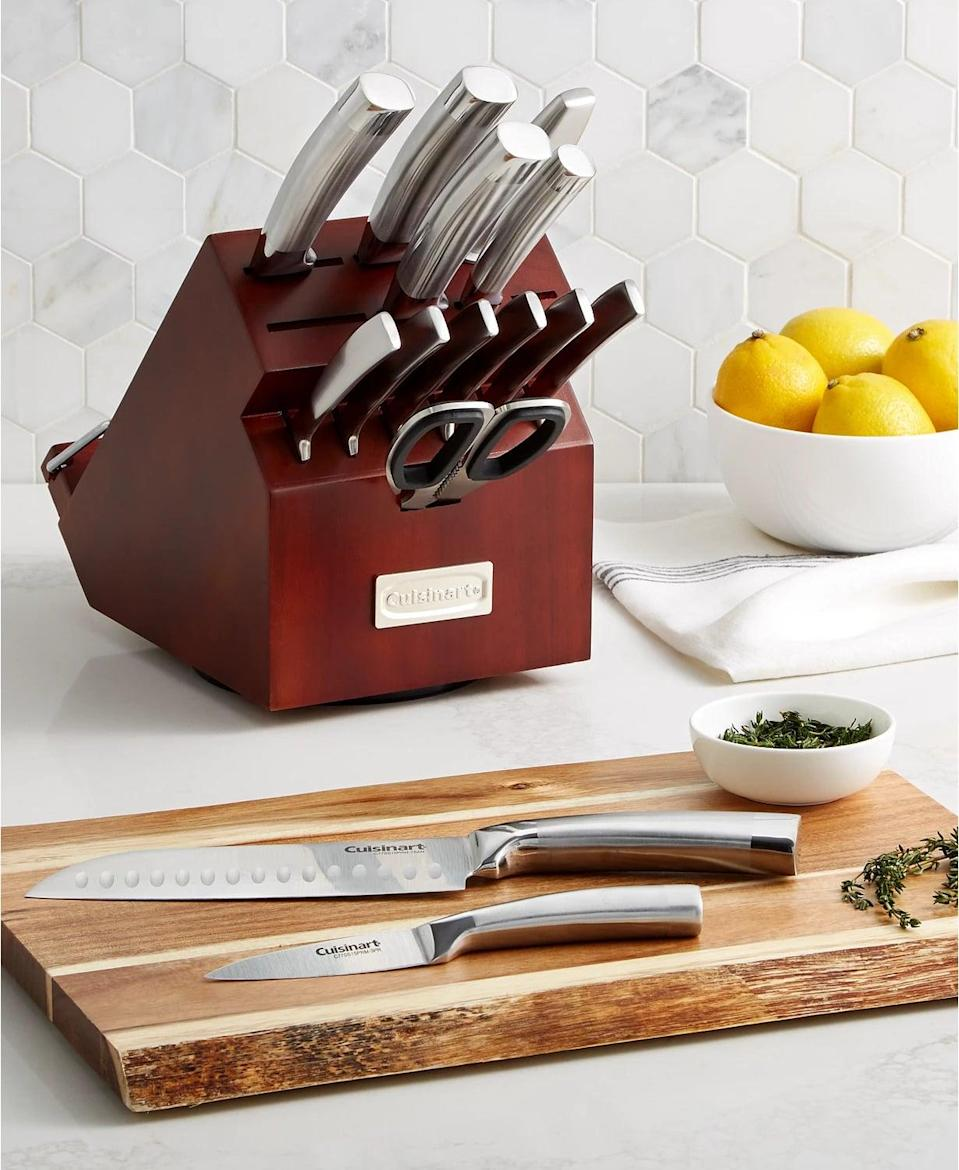 <p>Chop and slice with ease with the <span>Cuisinart 15-Piece Classic Rotating Block Cutlery Set</span> ($102). The set includes an eight-inch chef's knife, an eight-inch slicing knife, an eight-inch bread knife, a seven-inch Santoku knife, an 5.5-inch utility knife, a 3.5-inch paring knife, six 4.5-inch steak knives, a knife sharpener, kichen shears and a rotating storage block.</p>
