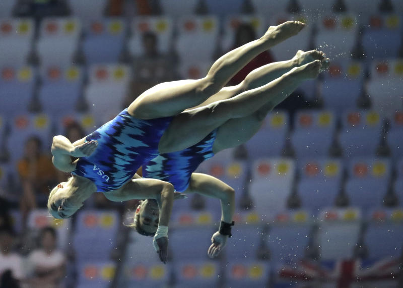 United States' Samantha Bromberg and Katrina Young compete in the 10m platform women's synchro diving final at the World Swimming Championships in Gwangju, South Korea, Sunday, July 14, 2019. (AP Photo/Lee Jin-man)