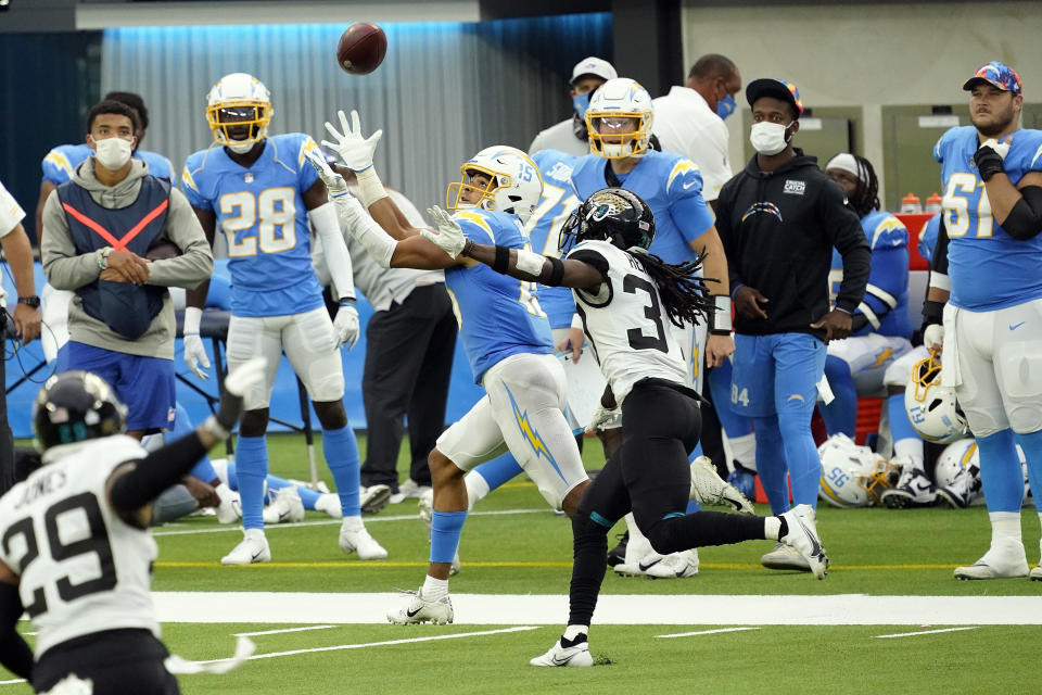 Los Angeles Chargers wide receiver Jalen Guyton (15) catches a touchdown past in front of Jacksonville Jaguars cornerback Tre Herndon during the second half of an NFL football game Sunday, Oct. 25, 2020, in Inglewood, Calif. (AP Photo/Alex Gallardo )