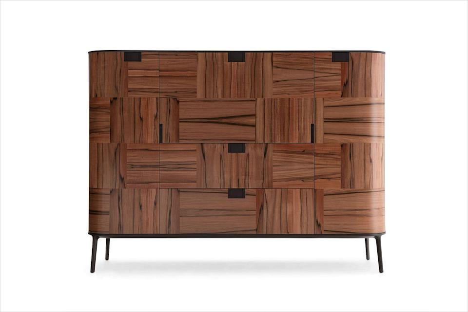 """<p><strong>JL:</strong> This is a dresser for lovers of wood grain. All of the elements sit in perfect harmony. </p><p><strong>JH:</strong> The rounded edges give a midcentury modern sensibility, and there's a lot of strength in the versatility of it.</p><p><em>71"""" w. x 20"""" d. x 50"""" h.; price upon request. <a href=""""https://www.bebitalia.com/en/"""" rel=""""nofollow noopener"""" target=""""_blank"""" data-ylk=""""slk:bebitalia.com"""" class=""""link rapid-noclick-resp"""">bebitalia.com</a></em></p>"""