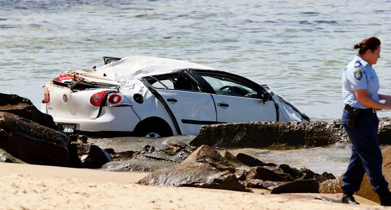 The car plunged from the cliff in Newcastle Thursday morning, hitting a mum and her baby. Source: AAP