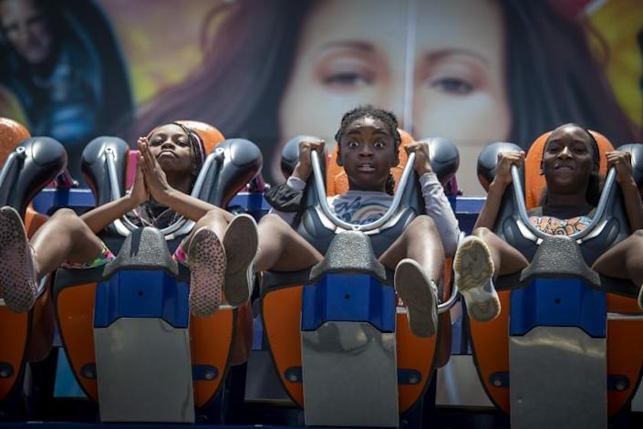 Costa Mesa, CA - July 16: From left: London Powell, 11, left, Symone Davenport, 11, Kamya Tucker, 14, of Long Beach, react as they ride the new Windsurf ride as the Orange County Fair returns Friday, opening its 23-day run following its pandemic-induced suspension last year at the OC Fair & Event Center in Costa Mesa Friday, July 16, 2021. The theme is ``Time for Fun.'' (Allen J. Schaben / Los Angeles Times)