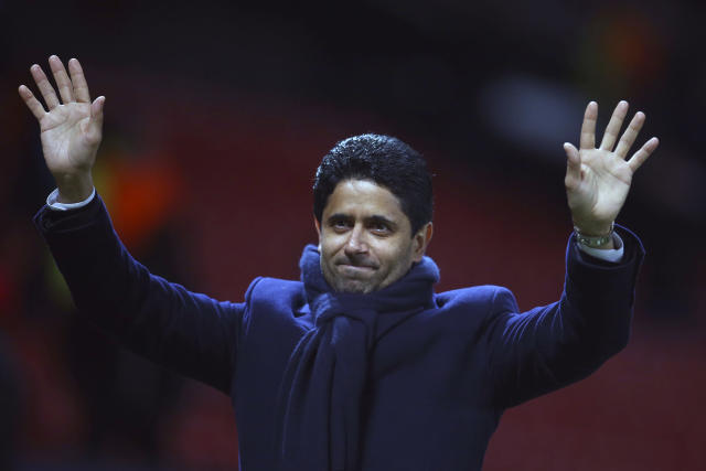 FILE - In this Tuesday, Feb. 12, 2019 file photo, Paris Saint Germain owner Nasser bin Ghanim Al-Khelaifi waves to teams fans at the end of their soccer match against Manchester United at Old Trafford stadium in Manchester, England. Under investigation in French and Swiss criminal investigations, the president of PSG has been praised as a tremendous professional by his UEFA executive committee colleague Andrea Agnelli on Tuesday, Sept. 10. Nasser Al-Khelaifi and European Club Association chairman Agnelli have four-year terms to represent clubs on the European soccer bodys ruling panel. (AP Photo/Dave Thompson, file)