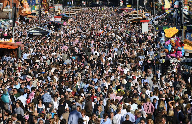 People attend the opening day of the 186th Oktoberfest in Munich, Germany September 21, 2019. REUTERS/Andreas Gebert