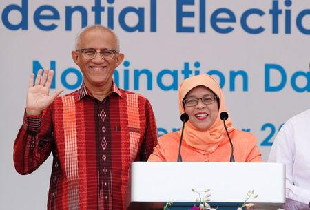Singapore's President-elect Halimah Yacob and her husband Mohammed Abdullah Alhabshee address supporters before leaving the nomination centre in Singapore