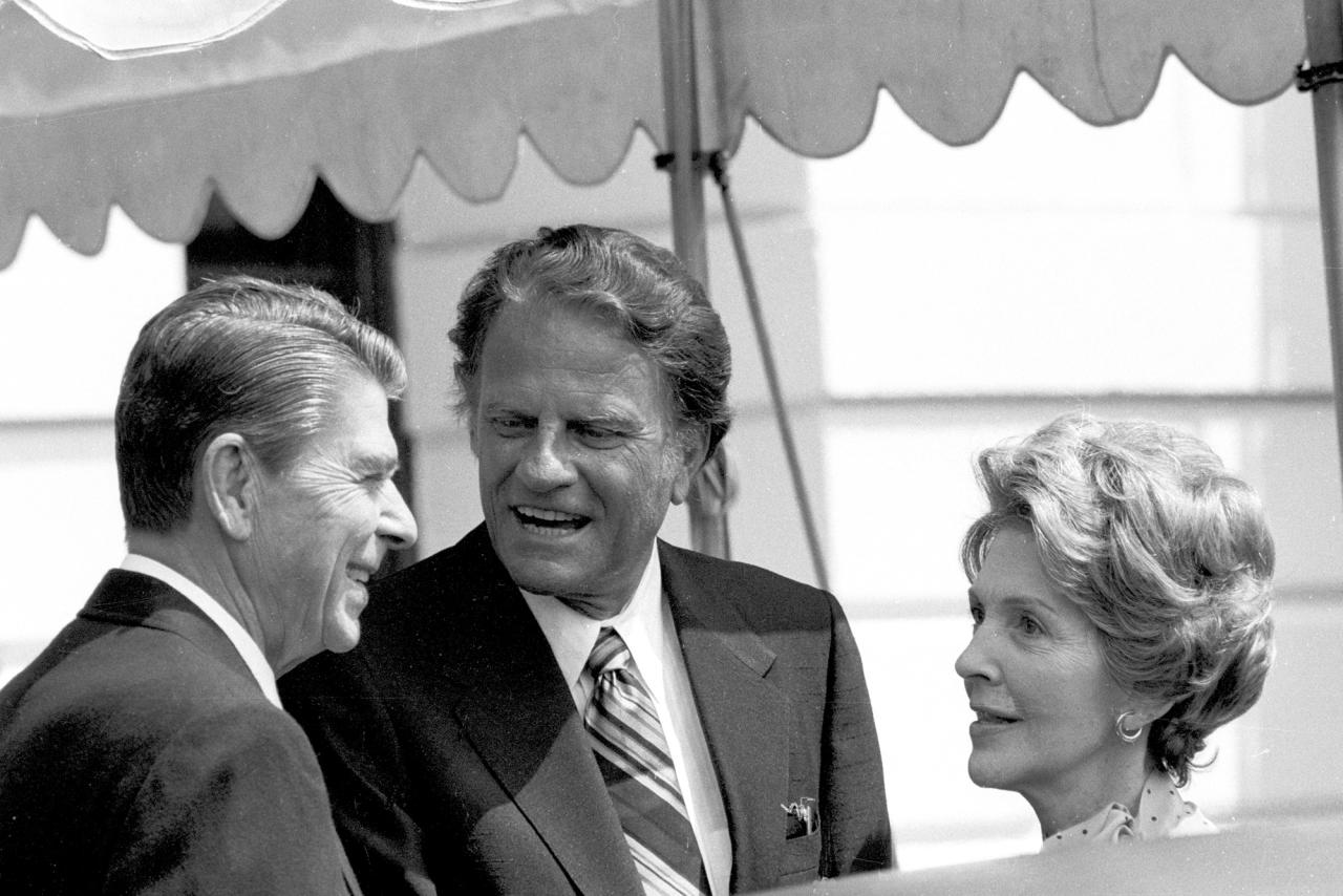 <p>The Rev. Billy Graham, center, talks with President Ronald Reagan and first lady Nancy Reagan at the White House on July 18, 1981. (Photo: J. Scott Applewhite/AP) </p>