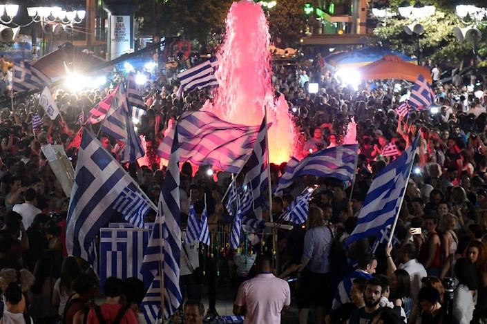 """The final results for the Greek bailout referendum showed that 61.31 percent voted """"No"""" and 38.69 percent """"Yes"""" (AFP Photo/Louisa Gouliamaki)"""