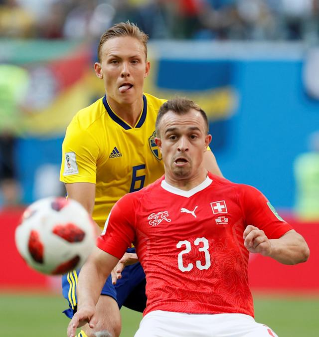 <p>Ludwig Augustinsson (L) of Sweden national team and Xherdan Shaqiri of Switzerland national team vie for the ball during the 2018 FIFA World Cup Russia Round of 16 match between Sweden and Switzerland at Saint Petersburg Stadium on July 3, 2018 in Saint Petersburg, Russia. (Photo by MB Media/Getty Images) </p>