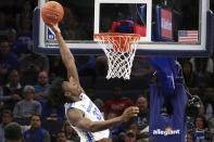 FILE - In this Tuesday, Nov. 5, 2019, file photo, Memphis' James Wiseman (32) dunks against South Carolina State during the first half of an NCAA college basketball game in Memphis, Tenn. Wiseman says he has withdrawn from school as the likely NBA lottery pick gets ready to begin his pro caree (AP Photo/Karen Pulfer Focht, File)