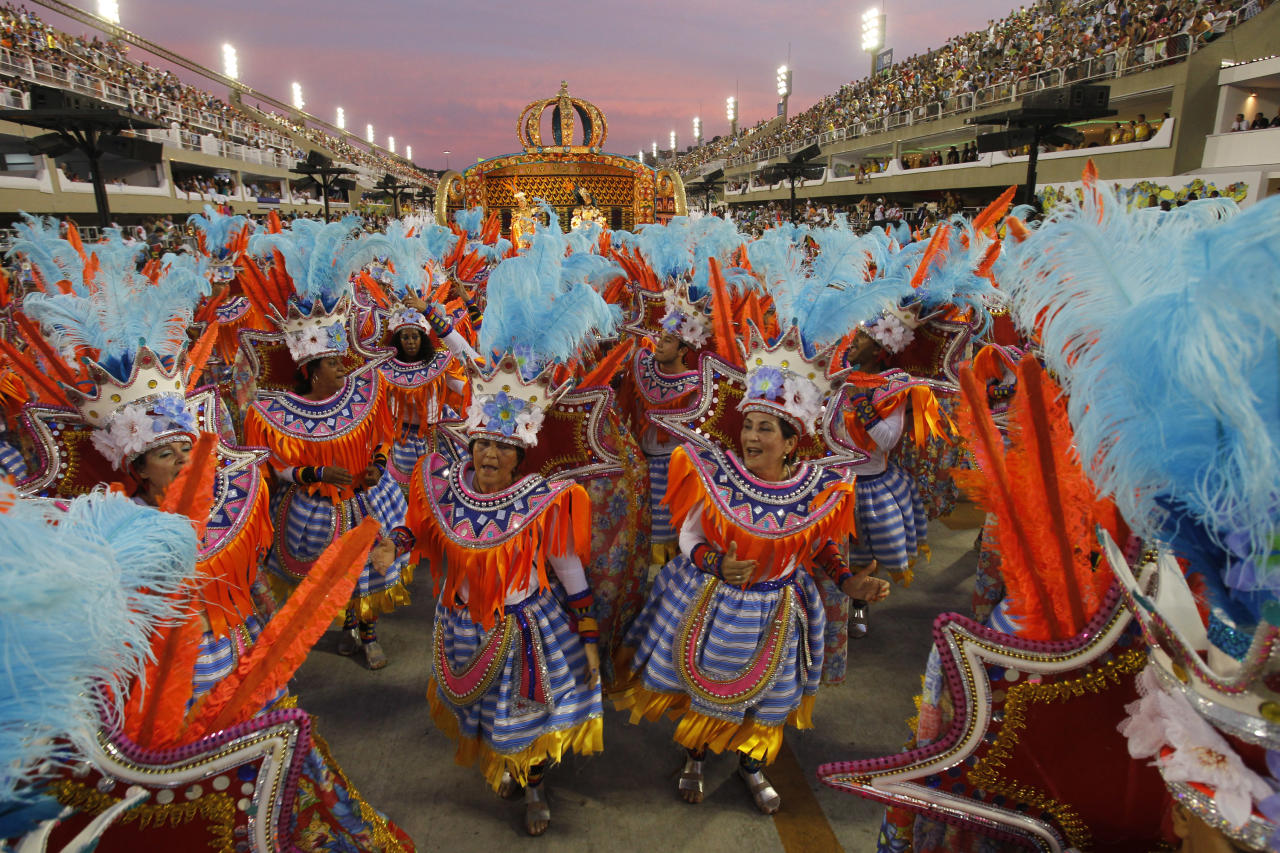 Performers from the Unidos da Vila Isabel samba school parade during carnival celebrations at the Sambadrome in Rio de Janeiro, Brazil, Monday, Feb.20, 2012. Millions watched the sequin-clad samba dancers at Rio de Janeiro's iconic Carnival parade. (AP Photo/Victor R. Caivano)