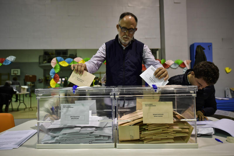 A member of a polling station sorts the postal votes, during the general election in Pamplona, northern Spain, Sunday, Nov. 10, 2019. As Spaniards voted Sunday in the country's fourth election in as many years, a leading leftist party pledged to help the incumbent Socialists in hopes of staving off a possible right-wing coalition government that could include a far-right party. (AP Photo/Alvaro Barrientos)