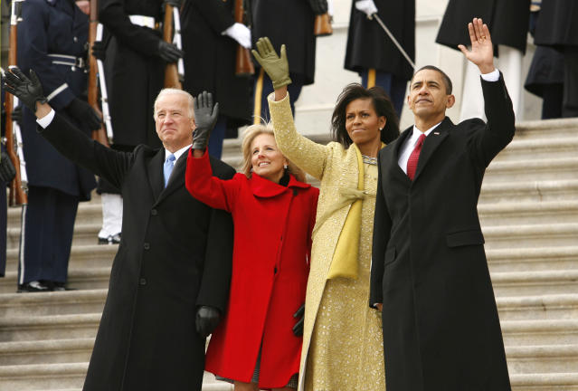 President Barack Obama, first lady Michelle, Vice President Joe Biden and his wife Jill wave as former President George W. Bush departs the U.S. Capitol during the inauguration ceremony in Washington, January 20, 2009. REUTERS/Kevin Lamarque