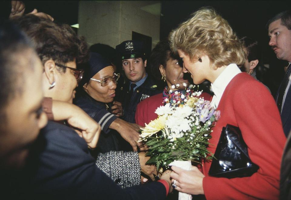 <p>Diana paid a visit to the AIDS unit of Harlem Hospital on her trip, wearing a red and white suit by Catherine Walker.</p>