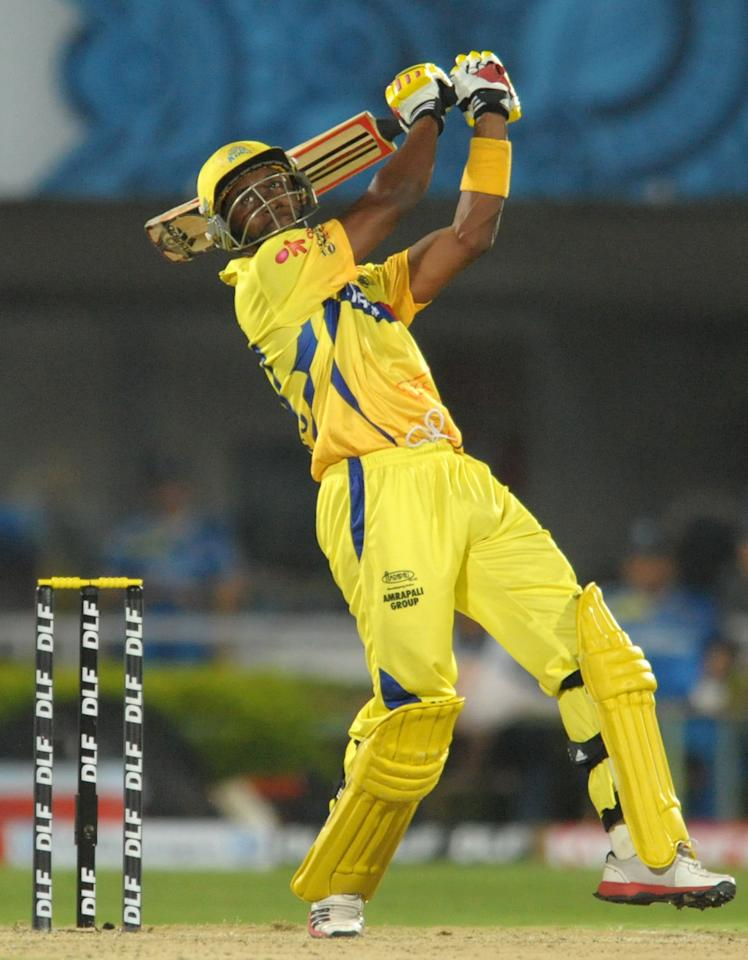 Chennai Super Kings batsman Dwayne Bravo plays a shot during the IPL Twenty20 cricket match between Chennai Super Kings and Deccan Chargers at The Dr. Y.S. Rajasekhara Reddy Cricket Stadium in Visakhapatnam on April 7, 2012. RESTRICTED TO EDITORIAL USE. MOBILE USE WITHIN NEWS PACKAGE. AFP PHOTO/Noah SEELAM (Photo credit should read NOAH SEELAM/AFP/Getty Images)