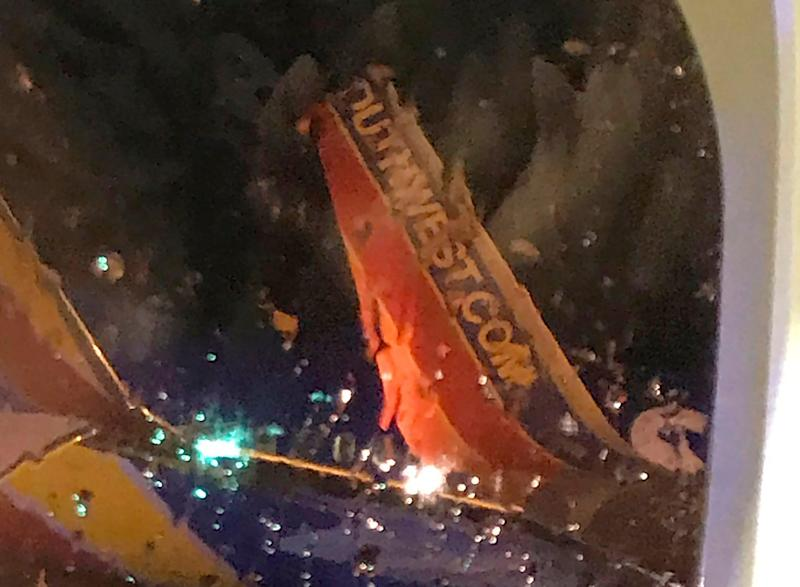 This photo taken on board by a passenger on a Southwest Airlines flight to Atlanta appears to show the top fin of another Southwest Airlines plane clipped off after the planes collided on Saturday night on the tarmac of Nashville International Airport in Tennessee. The airline says both planes returned to the gate under their own power and were taken out of service for evaluation. No one was injured.