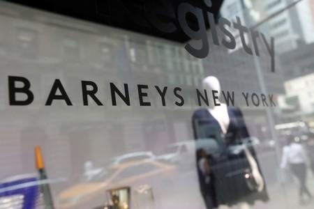 FILE PHOTO: The Barneys New York sign is seen in a display window outside the luxury department store in New York