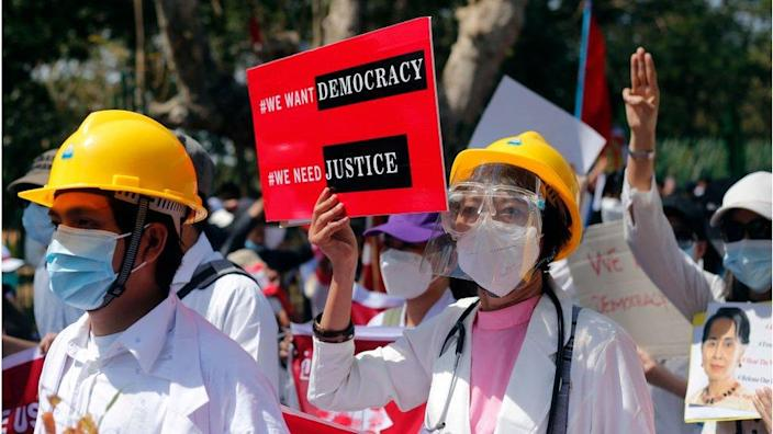 Myanmar doctors march while participating in demonstrations against military coups