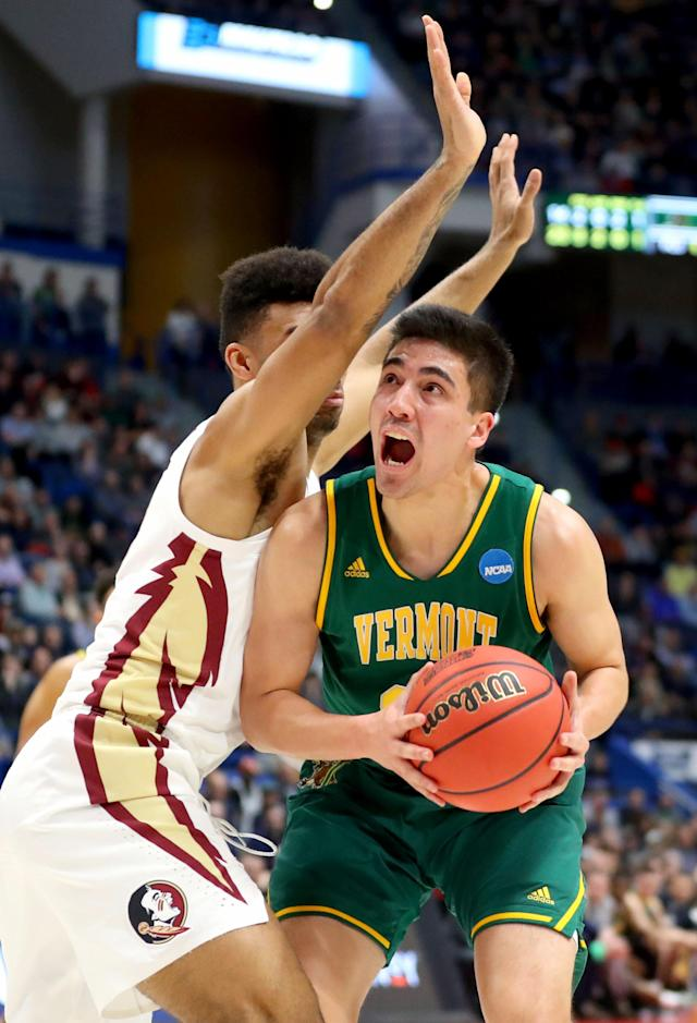 <p>Everett Duncan #21 of the Vermont Catamounts drives the basket against Anthony Polite #13 of the Florida State Seminoles during their first round game of the 2019 NCAA Men's Basketball Tournament at XL Center on March 21, 2019 in Hartford, Connecticut. (Photo by Maddie Meyer/Getty Images) </p>