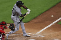 Chicago White Sox Tim Anderson hits an RBI single during the fourth inning of a baseball game against the Cincinnati Reds, Tuesday, May 4, 2021 in Cincinnati. (AP Photo/Aaron Doster)