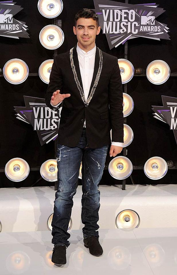 """Joe Jonas -- who had the very important job of introducing Chris Brown's high-flying performance -- donned a dress shirt, blazer, distressed jeans, and black shoes. What did you think of his buttoned-up look? Jason Merritt/<a href=""""http://www.gettyimages.com/"""" target=""""new"""">GettyImages.com</a> - August 28, 2011"""