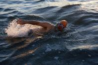 A swimmer with the Dolphin Club swims in San Francisco Bay near Alcatraz Island during the annual New Year's Day swim to Aquatic Park in San Francisco, California January 1, 2015. REUTERS/Stephen Lam (UNITED STATES - Tags: SOCIETY ANNIVERSARY)