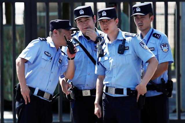 <p>Policemen take position at the site of a blast outside the U.S. Embassy in Beijing, China, July 26, 2018. (Photo: Damir Sagolj/Reuters) </p>