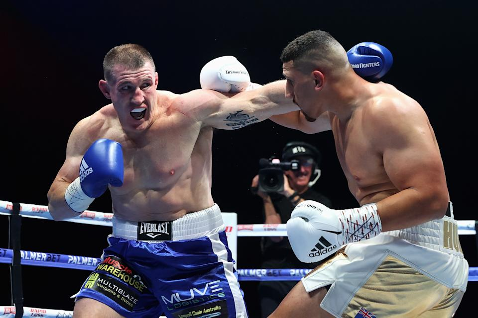 Paul Gallen (pictured left) throws a punch at Justis Huni (pictured right) during their boxing bout.