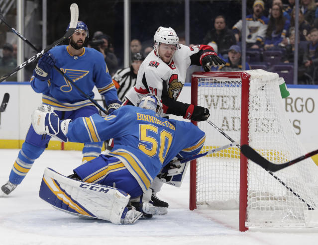 Ottawa Senators' Chris Tierney (71) pushes the puck in the net past St. Louis Blues goaltender Jordan Binnington (50) for a goal in the first period of an NHL hockey game, Saturday, Jan. 19, 2019, in St. Louis. (AP Photo/Tom Gannam)