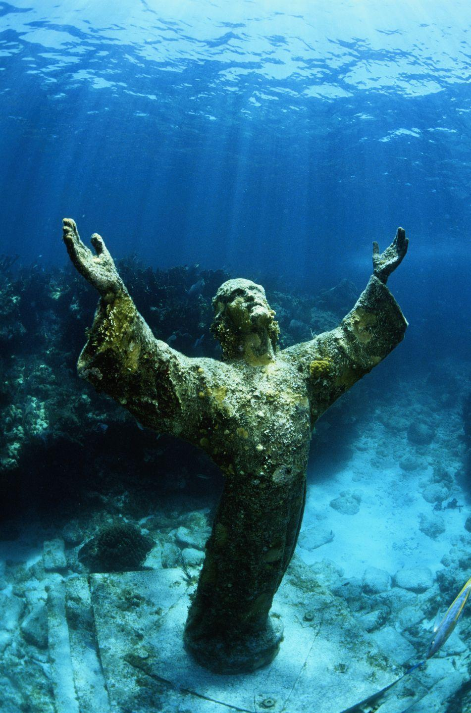 """<p>The 9-foot tall bronze statue was submerged underwater, off the coast of Key West, Florida, on August 25, 1965. It's the <a href=""""https://www.atlasobscura.com/places/christ-of-the-abyss-florida"""" rel=""""nofollow noopener"""" target=""""_blank"""" data-ylk=""""slk:third sculpture"""" class=""""link rapid-noclick-resp"""">third sculpture</a> cast from an original mold that created two other statues placed in the Mediterranean Sea (1954) and the Caribbean Sea (1961).</p>"""
