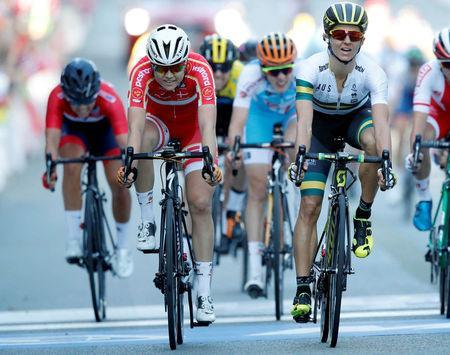 Katrin Garfoot (R) of Australia finished second and Amalie Dideriksen (L) of Denmark third in UCI Cycling Road World Championships Women Elite Road Race in Bergen, Norway September 23, 2017. NTB scanpix/Cornelius Poppe/via REUTERS