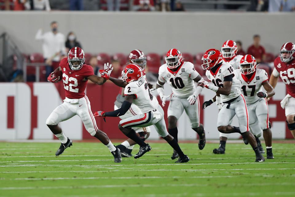 Alabama's Najee Harris, left, made hay against a good Georgia Bulldogs defense on Saturday. (Photo by UA Athletics/Collegiate Images/Getty Images)