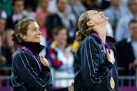 """Gold medalists <a href=""""http://sports.yahoo.com/olympics/beach-volleyball/misty-may-treanor-1134494/"""" data-ylk=""""slk:Misty May-Treanor"""" class=""""link rapid-noclick-resp"""">Misty May-Treanor</a> and <a href=""""http://sports.yahoo.com/olympics/beach-volleyball/kerri-walsh-jennings-1135351/"""" data-ylk=""""slk:Kerri Walsh Jennings"""" class=""""link rapid-noclick-resp"""">Kerri Walsh Jennings</a> celebrate on the podium during the medal ceremony for the Women's Beach Volleyball on August 8, 2012 in London, England. (Photo by Jamie Squire/Getty Images)"""