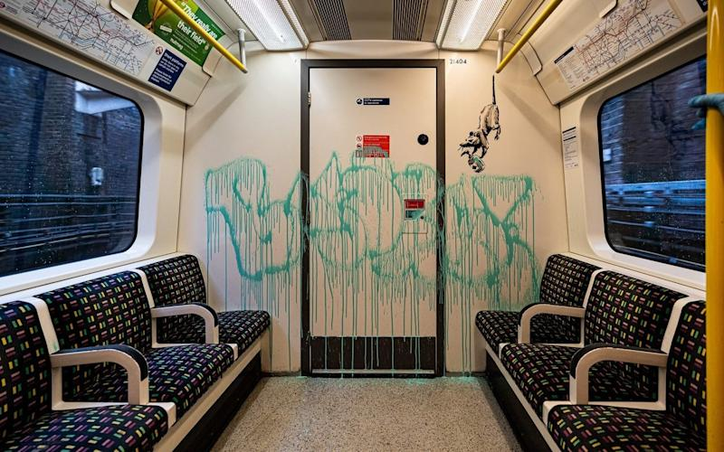 An artwork by Banksy is seen on a London underground carriage, Britain, in this undated picture obtained from social media. Instagram/Banksy /via REUTERS THIS IMAGE HAS BEEN SUPPLIED BY A THIRD PARTY. MANDATORY CREDIT. NO RESALES. NO ARCHIVES - Instagram/Banksy/Reuters