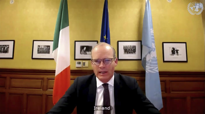In this image made from UNTV video, Ireland's Foreign Minister Simon Coveney speaks during a U.N. Security Council high-level meeting on COVID-19 recovery focusing on vaccinations, chaired by British Foreign Secretary Dominc Raab, Wednesday, Feb. 17, 2021. (UNTV via AP)
