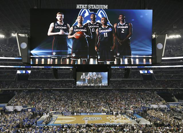 Connecticut is introduced before the NCAA Final Four tournament college basketball championship game against Kentucky, Monday, April 7, 2014, in Arlington, Texas. (AP Photo/Tony Gutierrez)