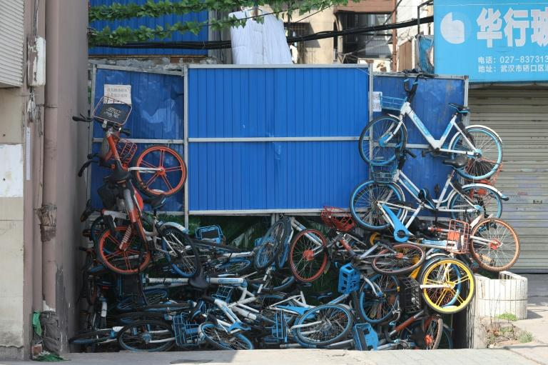 A barrier made from steel and piled-up bicycles blocks a street in Wuhan, in China, where the city's 11 million residents are still under strict quarantine