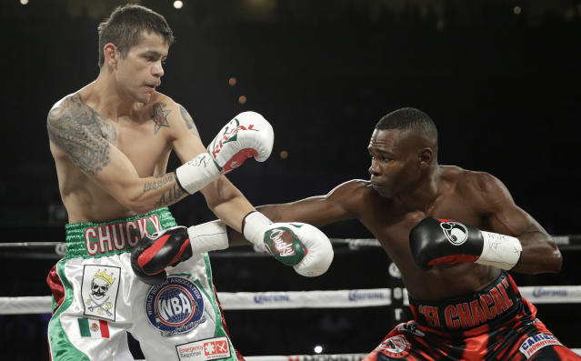 Guillermo Rigondeaux (R) throws a punch against Moises Flores during a victory in June 2017. (AP)