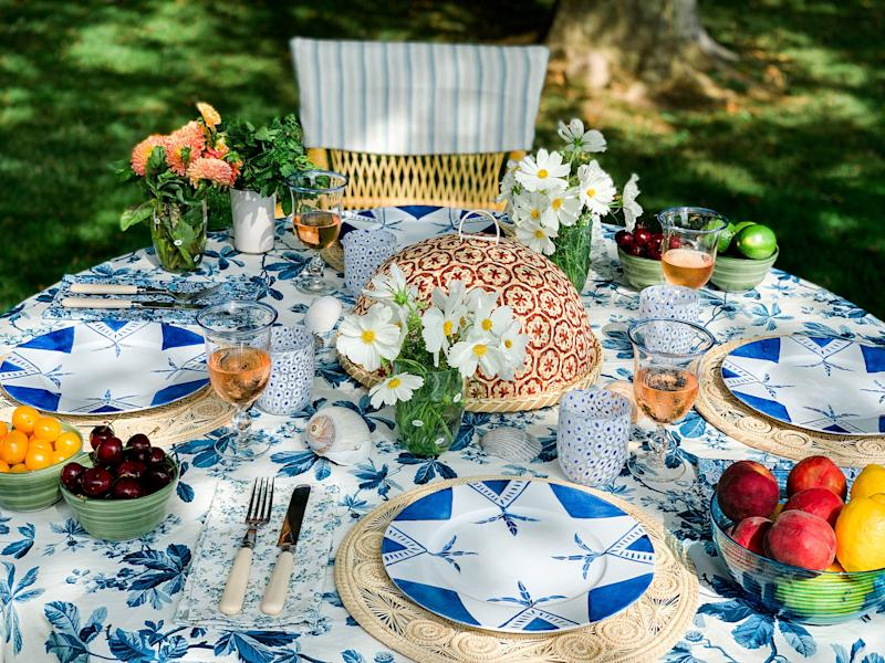 What's on her table: Aegean Star dinnerware, Endless Summer Tumblers, Blue Chestnut Tablecloth, Eloise Napkins, Fiesta Placemats, Classic Ivory Collection, Honeycomb Buffet, Soft Olive Everyday Bow.
