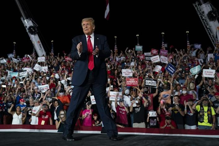 President Donald Trump walks off after speaking at a campaign rally at Orlando Sanford International Airport, Monday, Oct. 12, 2020, in Sanford, Fla. (AP Photo/Evan Vucci)