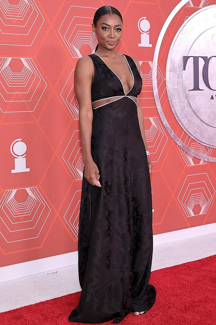<p>Patina Miller wore a black gown with cut outs on the red carpet. </p>