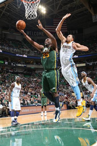 SALT LAKE CITY, UT - NOVEMBER 26: Al Jefferson #25 of the Utah Jazz shoots a layup against JaVale McGee #34 of the Denver Nuggets at Energy Solutions Arena on November 26, 2012 in Salt Lake City, Utah. (Photo by Melissa Majchrzak/NBAE via Getty Images)