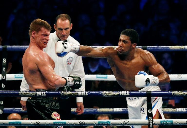 Anthony Joshua sends Aleander Povetkin tumbling to the canvas in the seventh round of their heavyweight world title fight at Wembley