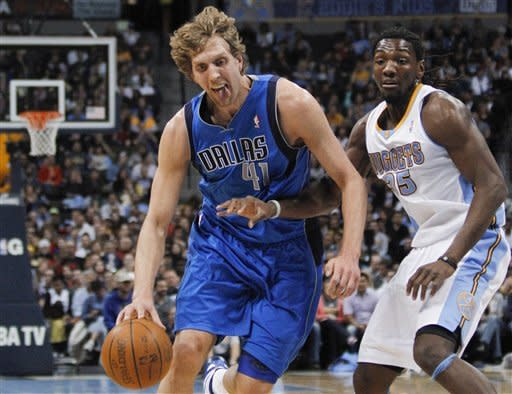 Dallas Mavericks forward Dirk Nowitzki (41) drives around Denver Nuggets forward Kenneth Faried (35) during the first quarter of an NBA basketball game Monday, March 19, 2012, in Denver. (AP Photo/Barry Gutierrez)