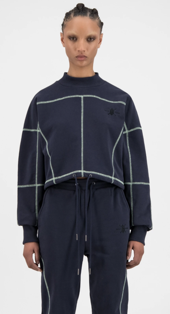 """<p><strong>Daily Paper</strong></p><p>dailypaperclothing.com</p><p><strong>$150.00</strong></p><p><a href=""""https://www.dailypaperclothing.com/collections/women-all/products/navy-iris-heoblai-sweater?variant=31248385769606"""" rel=""""nofollow noopener"""" target=""""_blank"""" data-ylk=""""slk:Shop Now"""" class=""""link rapid-noclick-resp"""">Shop Now</a></p><p>The navy colorway, with edgy neon threading feels cool and sleek. You should add this to your sweatshirt collection ASAP.</p>"""
