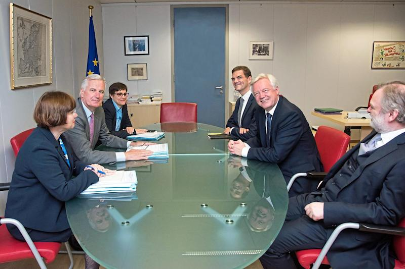Getting down to business: the EU's chief negotiator Michel Barnier, second left, and Brexit Secretary David Davis, right, starting talks at the European Union's headquarters in Brussels last month: PA Wire