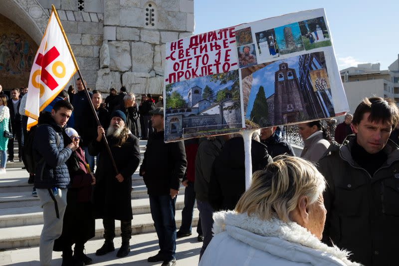 People gather at the Cathedral of the Resurrection of Christ ahead of a parliament vote for a bill on 'Religious freedoms and legal rights of religious organizations' in Podgorica