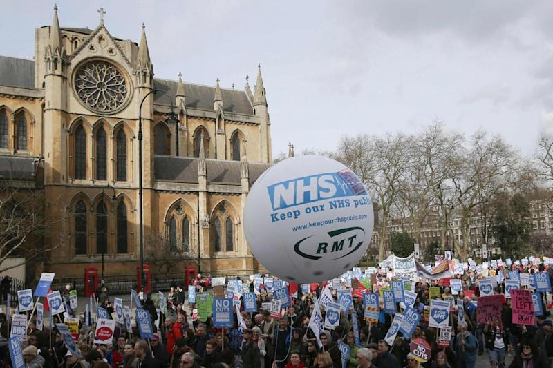 NHS protest: Crowds hold their banners aloft during the march (AFP/Getty Images)